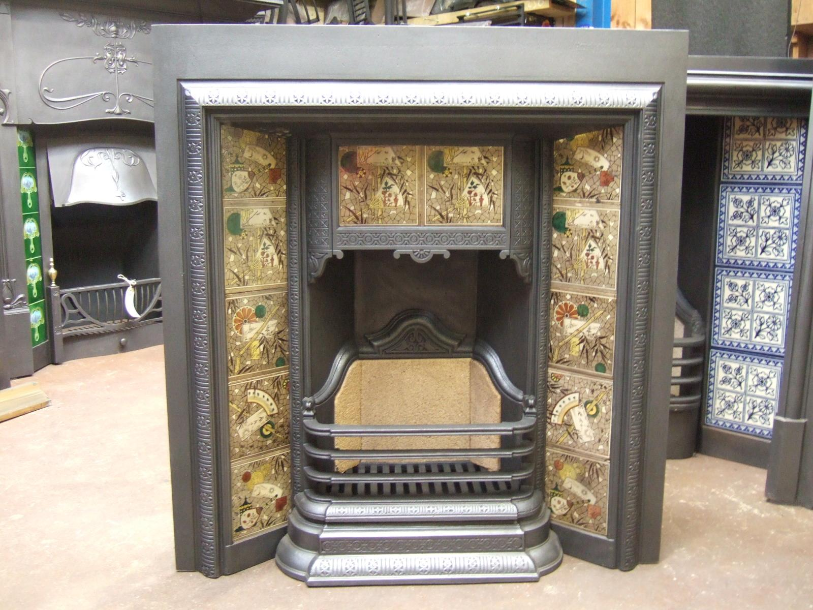 Attractive Arts and Crafts tiled fireplace insert. In excellent condition. From a house in Kingston Upon Thames