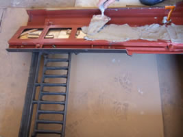 Wedge the tiles in position and plaster in - Antique Fireplace Co fitting instructions